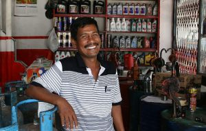 Business Services - A_successful_auto-garage_store_owner_in_Banda_Aceh-1-300x190